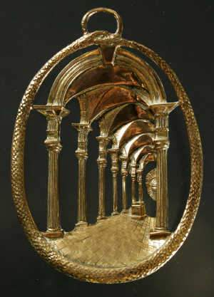Gilt brass oval medallion
