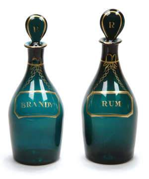 Pair of green mallet-shaped decanters
