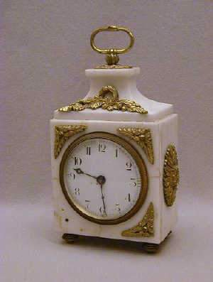 ORMOLU AND WHITE MARBLE TIMEPIECE