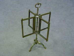 Brass four section revolving picture frame