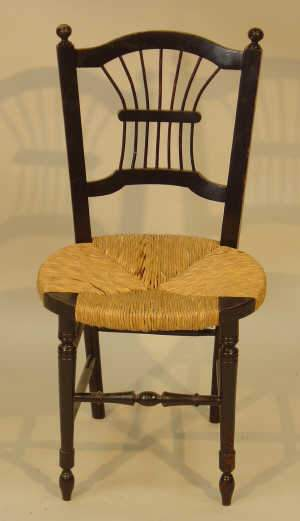 Ebonised spindle back chair of William Morris design