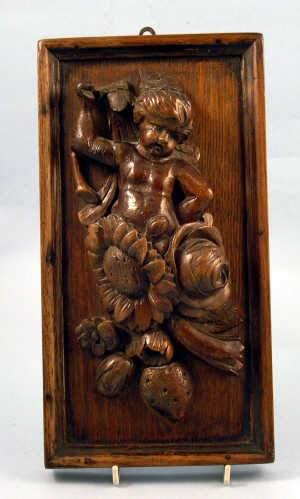 A 19th century Continental carved oak applique panel