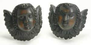 Pair of oak winged cherub head wall appliques