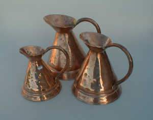 Set of three 19thC graduated copper water jugs