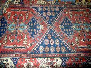 Persian rug red and blue in colour