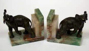 Pair of green patinated figures of bronze elephants