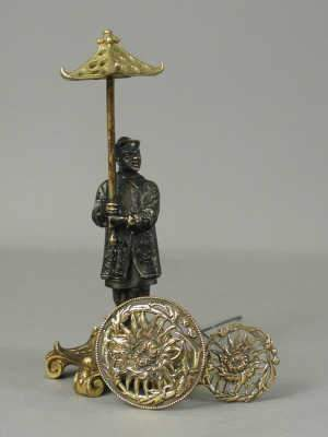 Bronze hat pin holder in the form of a chinaman