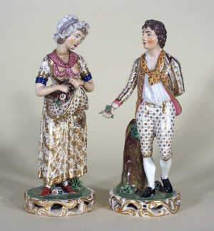 Pair of Derby porcelain figures of a flower girl