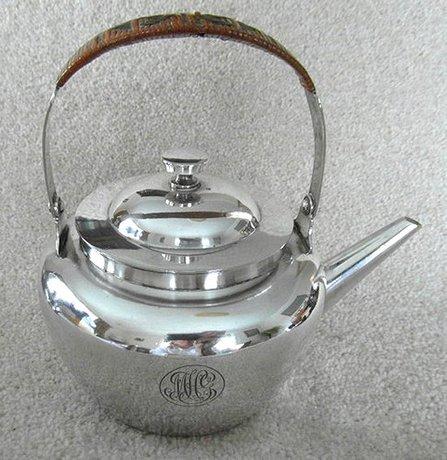 A Silver Plated Tea Pot by Dr Christopher Dresser Hukin & Heath