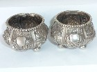 ANTIQUE PAIR CHINESE SILVER SALTS FIGURES BUILDINGS FOLIAGE - SIGNED TO BASE
