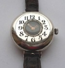 WW1 half hunter cased men's silver wristwatch.