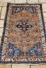 An Antique Persian Rug