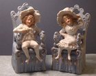 Pair of German Bisque Seated Child Figures